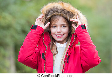 Leisure, activity, lifestyle. Child in red coat and hood...
