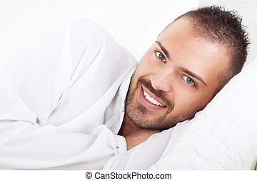 Leisure Activity - Beautiful young man resting at home.
