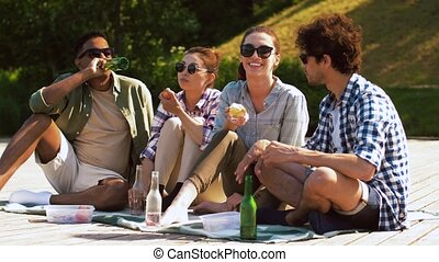 friends having picnic on wooden terrace - leisure and people...
