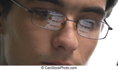 Leisure Browsing - Close up of male eyes in glasses where...