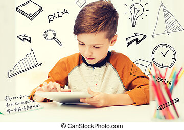 close up of boy with tablet pc computer at home