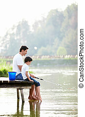 Leisure - Father and son fishing on the lake
