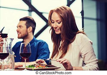 happy couple having dinner at restaurant