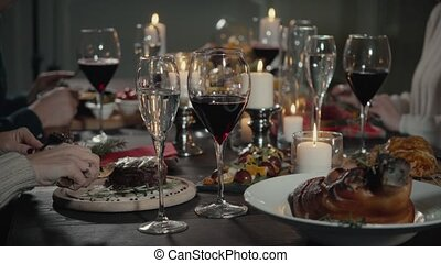 leisure, food, drinks, people and holidays concept - happy friends eating and drinking at restaurant.