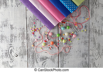 Leisure for woman concepr. Beads on table with sewing utencils