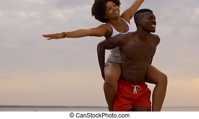 happy couple having fun on summer beach - leisure, freedom...
