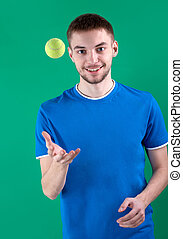 Leisure game - Portrait of young man playing with tennis...