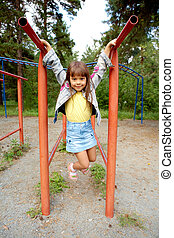 Leisure games - Portrait of little playful girl looking at...
