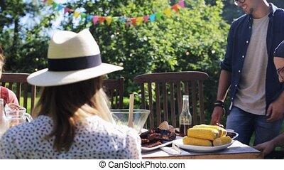 friends gathering for dinner at summer garden - leisure,...
