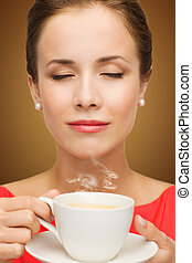 beautiful woman in red dress with cup of coffee