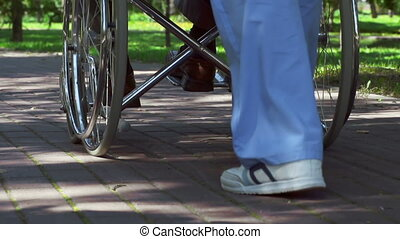 Leisure Walk - Low section of unrecognizable caregiver...