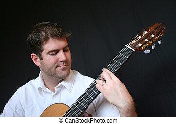 leka för gitarr, man