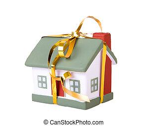 leksak, litet hus, med, a, guld, bow.