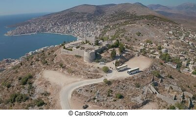 Lekuresi Castle historical ruins and panorama of the Sarande in Albania
