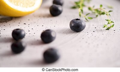 Lemon and blueberries on kitchen countertop.