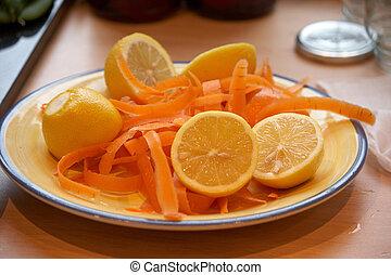 Lemon and carrot peel on a plate
