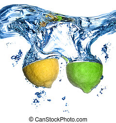 lemon and lime dropped into water with bubbles isolated on ...
