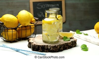 Lemon and lime slices in water jars and straws in summer...