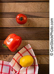 Lemon and pepper on a wooden table