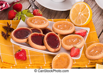 Lemon and straberry tartlets.