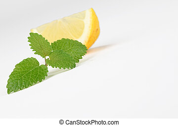 Lemon balm and lemon - Fresh lemon balm leaf and a slice of...