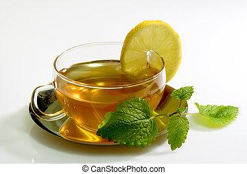 Lemon Balm Tea - Lemon balm tea in a glass cup with garnish...