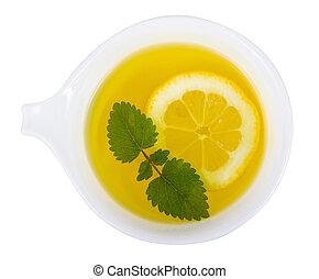 Lemon balm tea over white background