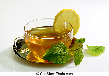 Lemon Balm Tea - Lemon balm tea in a glass cup with garnish...