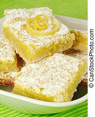 Lemon Bars - Baked lemon bars sprinkled with powdered sugar.