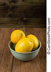 Lemon bowl on a wooden table