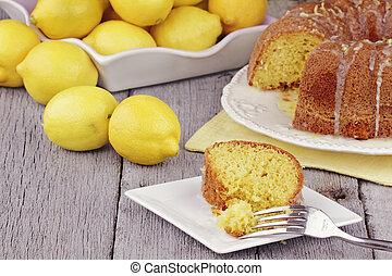 Lemon Bundt Cake - Slice of moist lemon bundt cake with real...