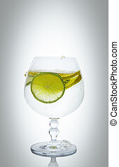 lemon carbonated drink with lime in a glass
