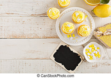 Lemon cupcakes for Easter brunch with yellow frosting and...