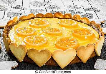 Lemon custard tart, decorated with biscuits, top view,...