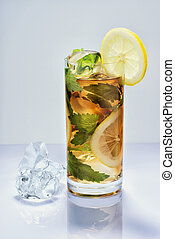 Lemon drink with ice in a glass on white surface - Lemon...