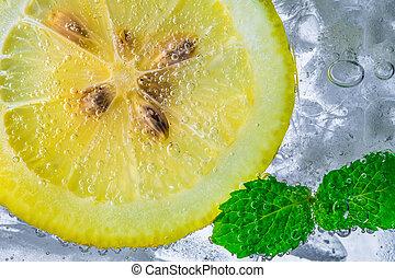 Lemon drop in fizzy sparkling water, juice refreshment