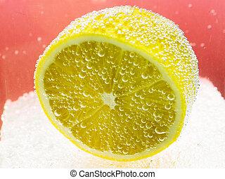 lemon floating in soda water