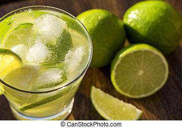 Lemon Fruit Caipirinha of Brazil on wooden background
