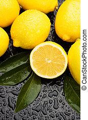 Lemon fruit on wet background
