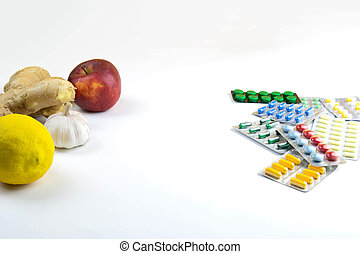 Lemon, ginger, a chapel and apples against multi-colored tablets. The concept of choosing a healthy diet versus taking medication