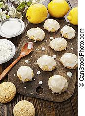Lemon glaze cookies on the wooden table