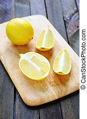 lemon halves on chopping board