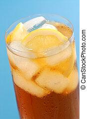 Lemon iced tea - Glass of cold lemon iced tea with ice and...