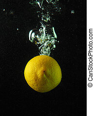 Lemon in the bubbles on a dark background