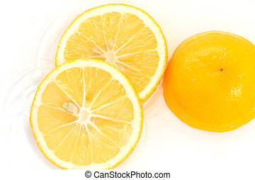 lemon in water on a white background