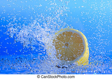 Lemon in water with bubbles.