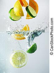 Lemon, lime and orange splash in clear wather