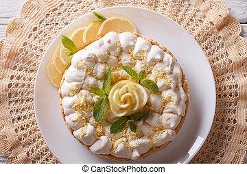 lemon meringue cake close up on the table. horizontal top view