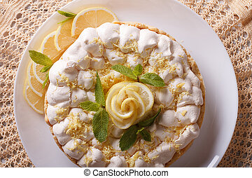 lemon meringue pie close-up on a plate. Horizontal top view