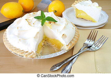 Lemon Meringue Pie - Lemon Meringue pie with a slice cut out...
